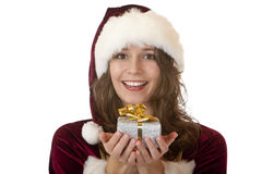 Happy Santa Claus woman holding Christmas gift Stock Image