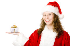Happy Santa Claus woman holding Christmas gift Royalty Free Stock Photography