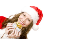 Happy Santa Claus woman holding Christmas gift box Royalty Free Stock Images