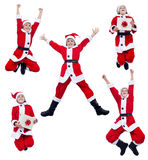 Happy santa costume boy jumping Royalty Free Stock Image