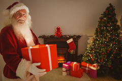 Happy santa delivering presents at christmas eve Royalty Free Stock Photos