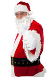 Happy santa gesturing thumbs up Stock Photo