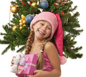 Happy Santa girl. Near the christmas tree Stock Photography