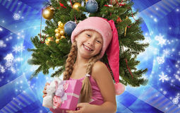 Happy Santa girl. Near the christmas tree Stock Image