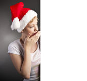 Happy santa girl with blank banner in hands Royalty Free Stock Images