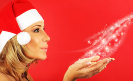 Happy Santa girl blowing a kiss Stock Photography