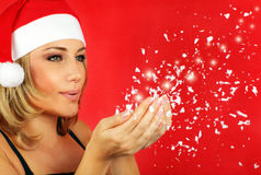 Happy Santa girl blowing a kiss Stock Images