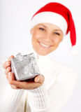 Happy Santa girl with a gift Stock Images