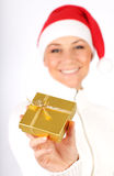 Happy Santa girl with a gift Royalty Free Stock Photo