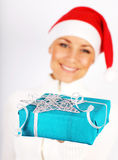 Happy Santa girl with gift Stock Photos