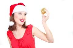 Happy santa girl with gift box Stock Image