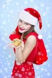 Happy santa girl with gift box. On xmas background Stock Photography
