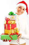 Happy Santa girl with gifts Stock Photo