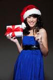 Happy santa girl with glass and gift Royalty Free Stock Images