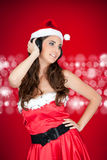 Happy santa girl with headphones Royalty Free Stock Photography