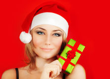 Happy Santa girl holding Christmas gift Stock Photo