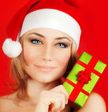 Happy Santa girl holding Christmas gift Stock Image