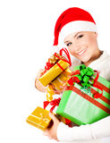 Happy Santa girl holding Christmas gifts Royalty Free Stock Image