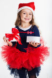 Happy santa girl is holding gift box Royalty Free Stock Photography