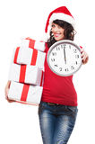 Happy santa girl holding gifts and clock Stock Image