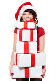 Happy santa girl holding many boxes with presents Royalty Free Stock Photography