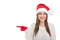 Happy Santa girl pointing left Royalty Free Stock Images