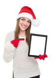 Happy Santa girl pointing at tablet computer screen Stock Photography