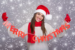 Happy Santa girl showing Merry Christmas sign Royalty Free Stock Image