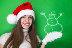 Happy Santa girl with Snowman drawing Stock Photos