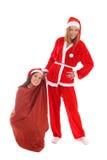 Happy santa with gnome in bag Stock Photos
