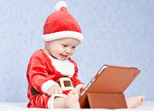 Happy santa helper baby boy Stock Photo