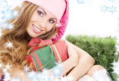 Happy santa helper with gift box Royalty Free Stock Photos