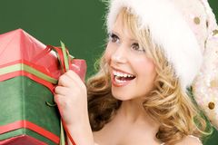 Happy santa helper with gift box Stock Photos