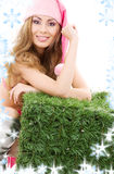 Happy santa helper with green cube. And snowflakes royalty free stock images