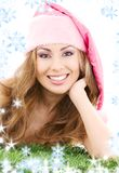 Happy santa helper in pink hat Stock Photo