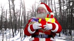 Happy Santa holding presents outdoor. stock video