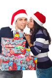 Happy Santa man being kissed by woman. Happy Santa man holding Christmas gifts and being kissed by woman isolated on white background Royalty Free Stock Images