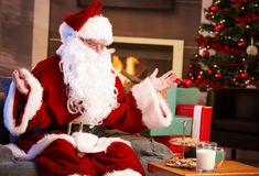 Happy Santa with milk and chocolate chip cookies Stock Images