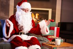 Happy Santa with milk and chocolate chip cookies Royalty Free Stock Images