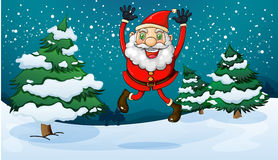 A happy Santa near the pine trees Stock Photo