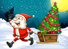 A happy Santa pulling the sleigh with a christmas tree Royalty Free Stock Images