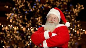 Happy Santa showing thumbs up. Santa Claus, bokeh background stock video