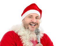 Lucky Santa singing Xmas songs. Lucky man in Santa Suit Costume singing in microphone Xmas songs Stock Image