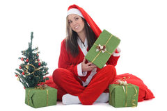 Happy santa with tree holding present Stock Photo