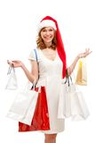Happy santa woman with bags. Christmas shopping. Stock Photography