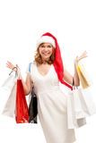 Happy santa woman with bags. Christmas shopping. Royalty Free Stock Photos