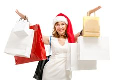 Happy santa woman with bags. Christmas shopping. Royalty Free Stock Photo