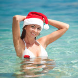 Happy santa woman on the beach Stock Photos