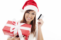 Happy santa woman with credit card Royalty Free Stock Images
