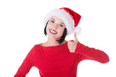 Happy santa woman gesturing thumbs up. Isolated on white Royalty Free Stock Photography